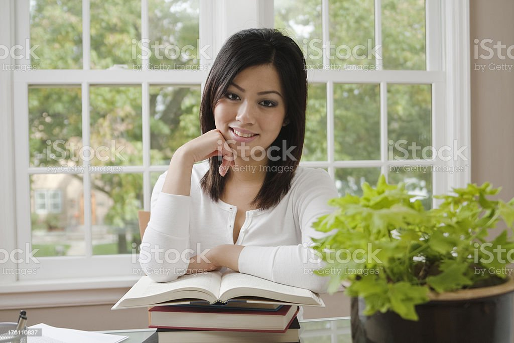 Young Asian Woman Student Studying in the Dorm royalty-free stock photo