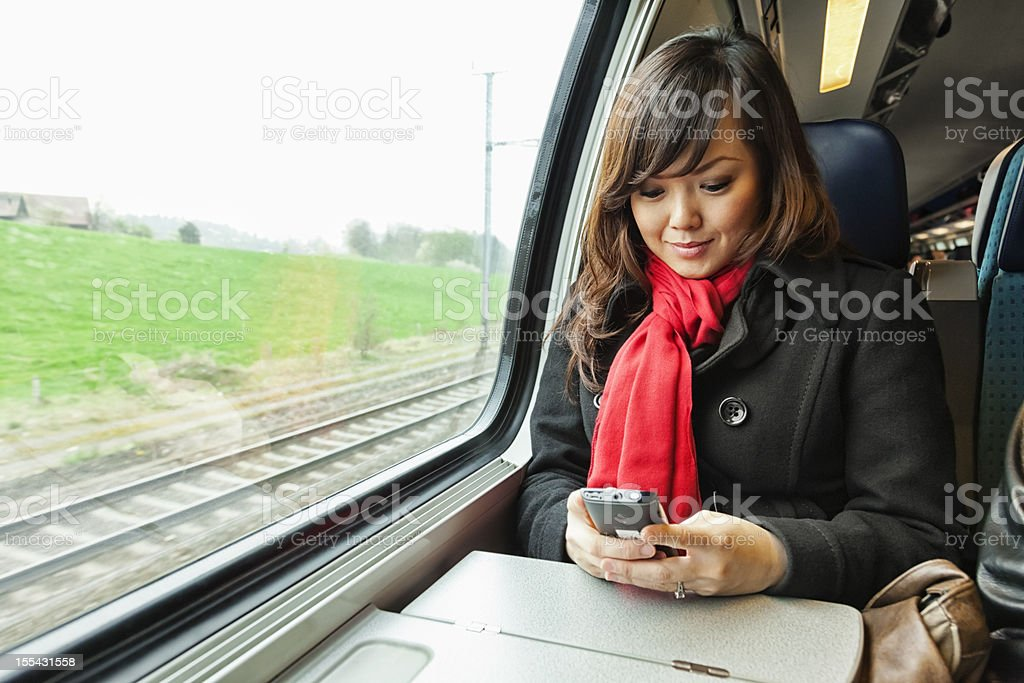 Young Asian Woman Traveling by Train royalty-free stock photo