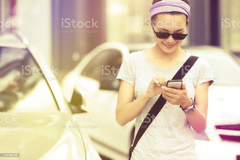 young asian woman use smartphone at city stock photo