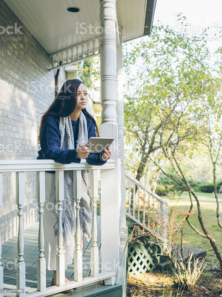 young asian woman using tablet stock photo