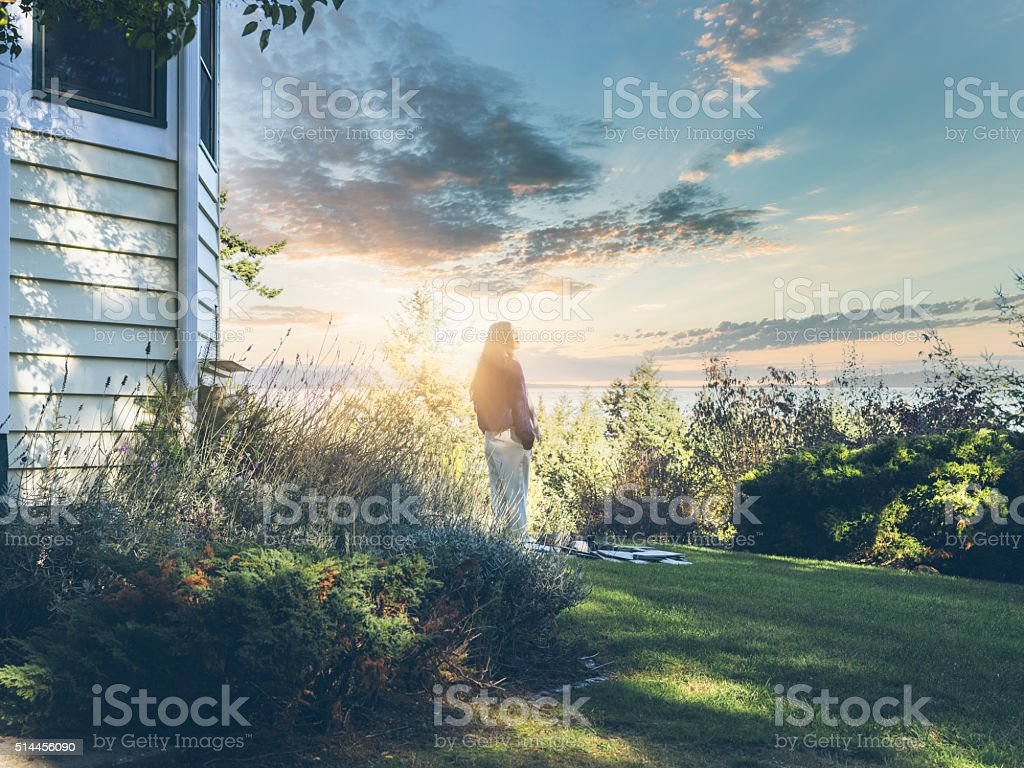 young asian woman watching sunrise stock photo