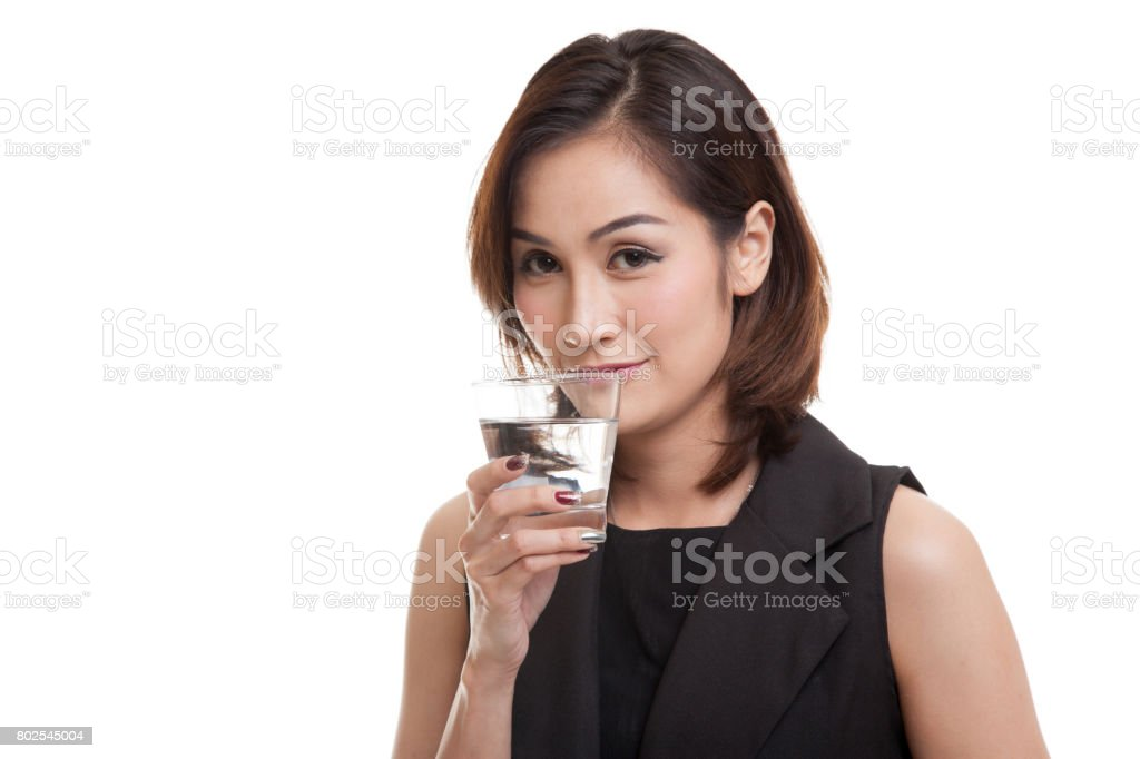 Young Asian woman with a glass of drinking water. stock photo
