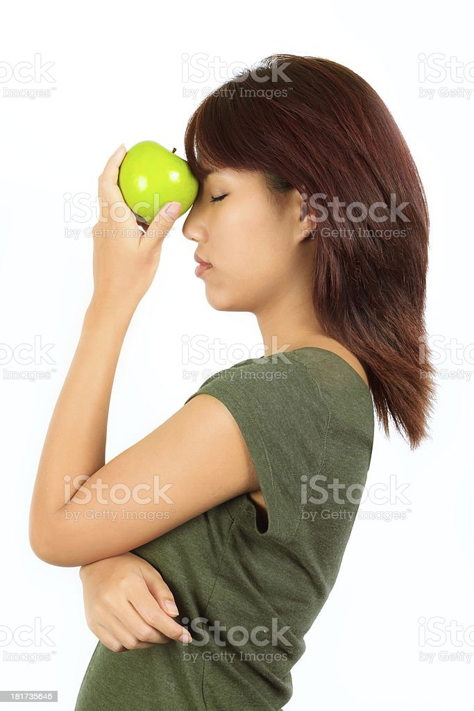 Young asian woman with a green apple. royalty-free stock photo