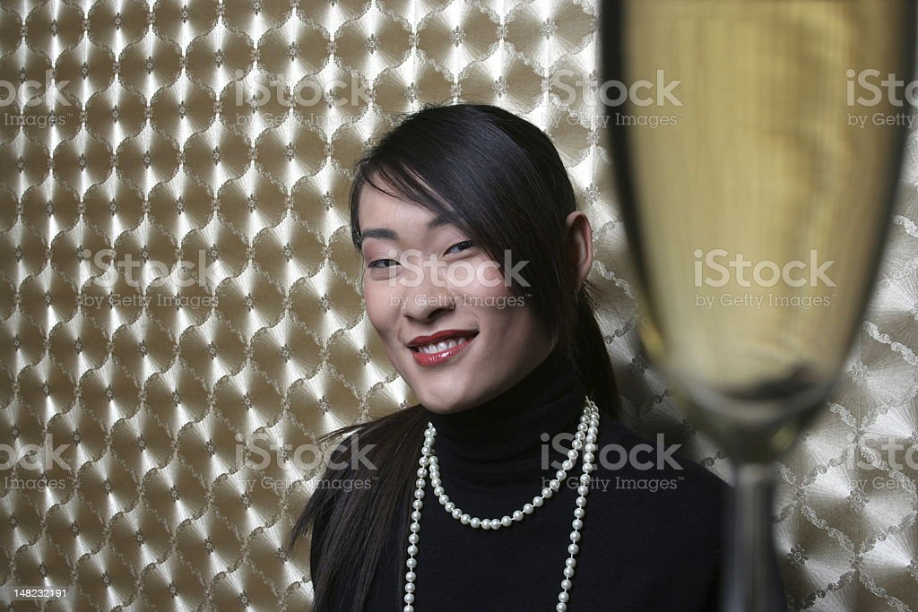 Young asian woman with champagne royalty-free stock photo