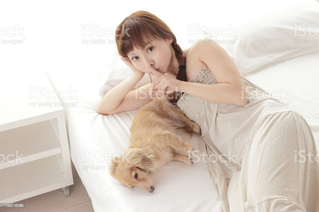 Young asian woman with dog royalty-free stock photo
