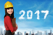 Young asian woman with safety helmet and 2017 year number