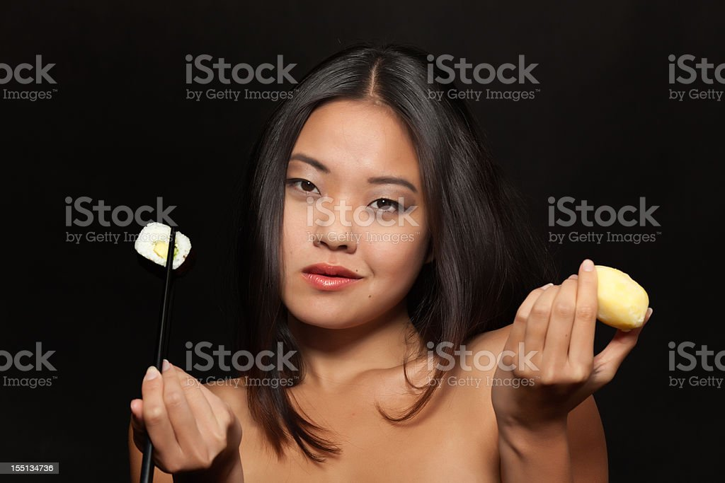 Young Asian woman with sushi and potato stock photo