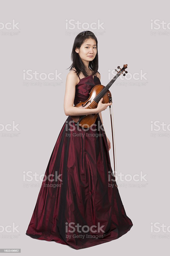 young asian woman with violin royalty-free stock photo