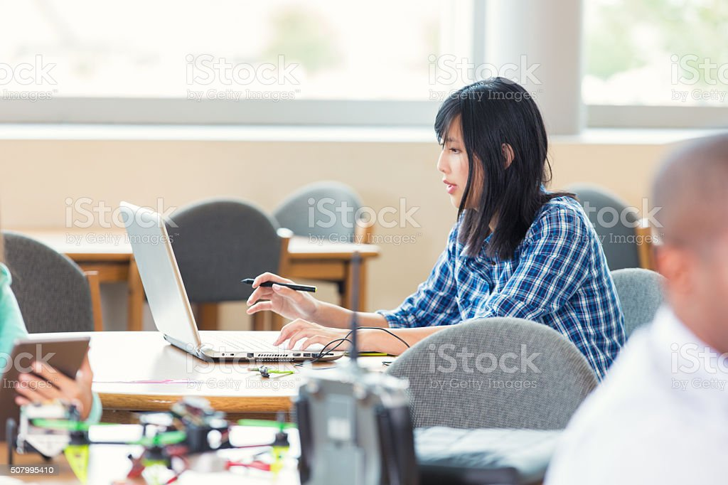 Young Asian woman works on project in design firm stock photo