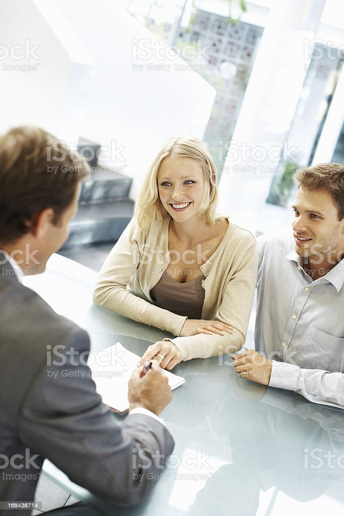 Young associates smiling at the head executive royalty-free stock photo