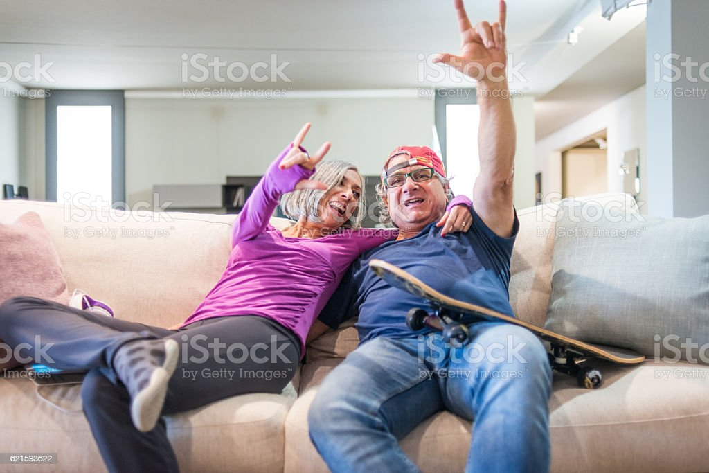 Young at heart grandparents series: Rock and roll sign stock photo