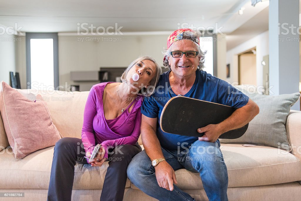 Young at heart grandparents series: Skateboard couple stock photo
