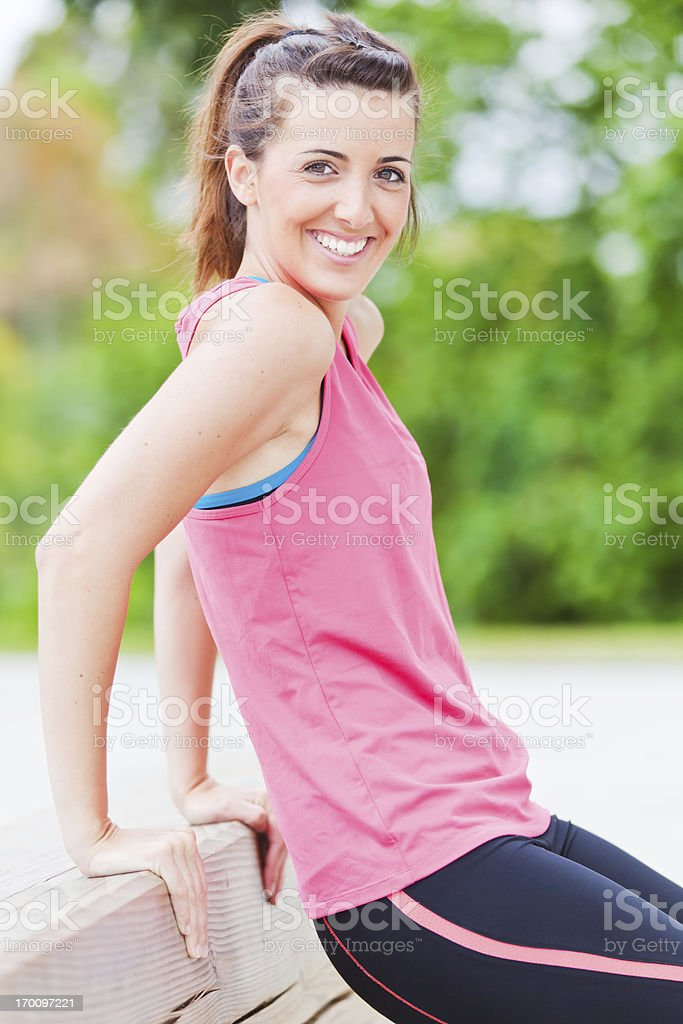 Young athlete doing triceps exercises using a bench stock photo