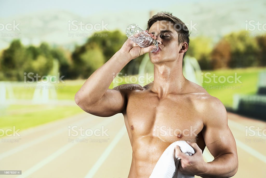 Young athlete having water royalty-free stock photo