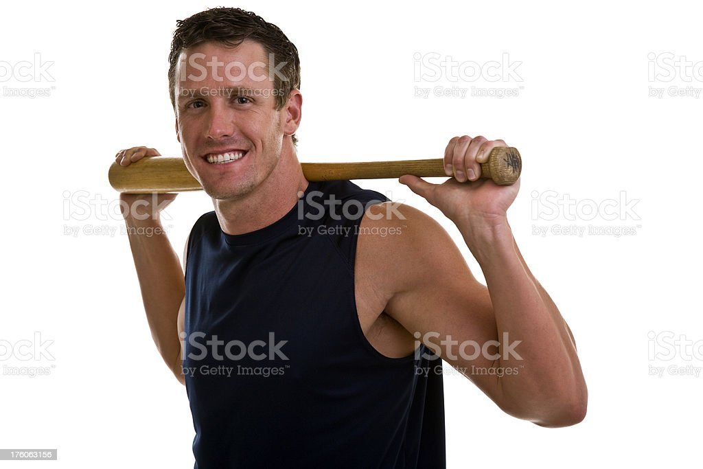 Young athlete holding baseball bat behind neck royalty-free stock photo