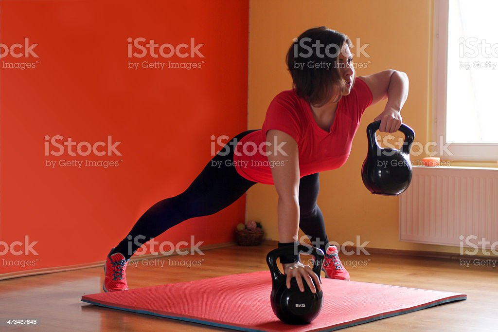 Young athlete in training position with kettle stock photo