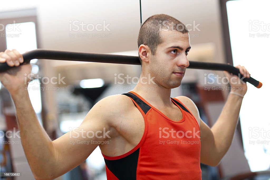 Young athlete lifting weights royalty-free stock photo