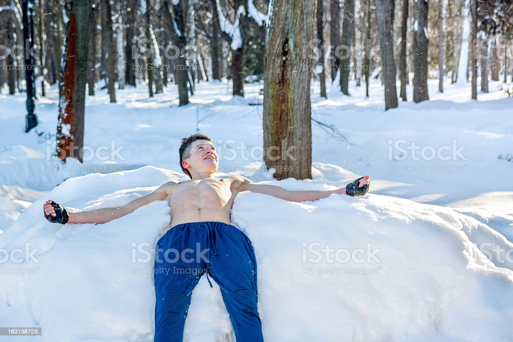 Young athlete lying on snow royalty-free stock photo