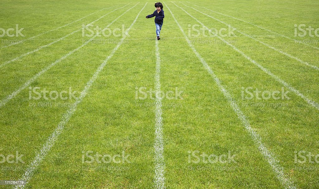 Young athlete on running track stock photo