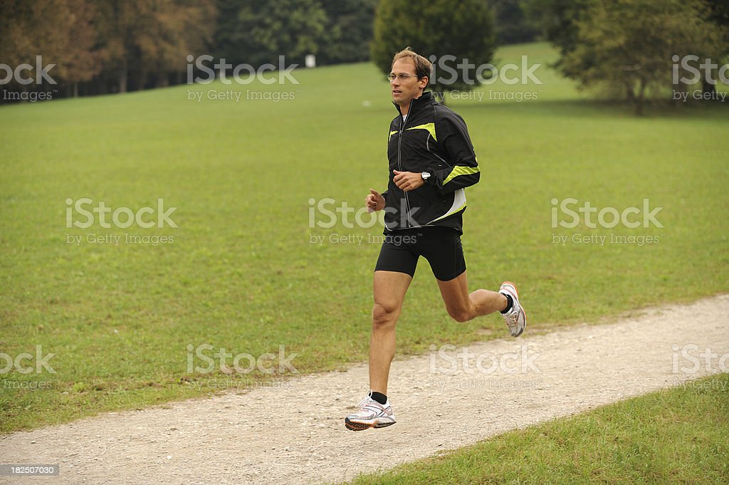 Young athlete running stock photo