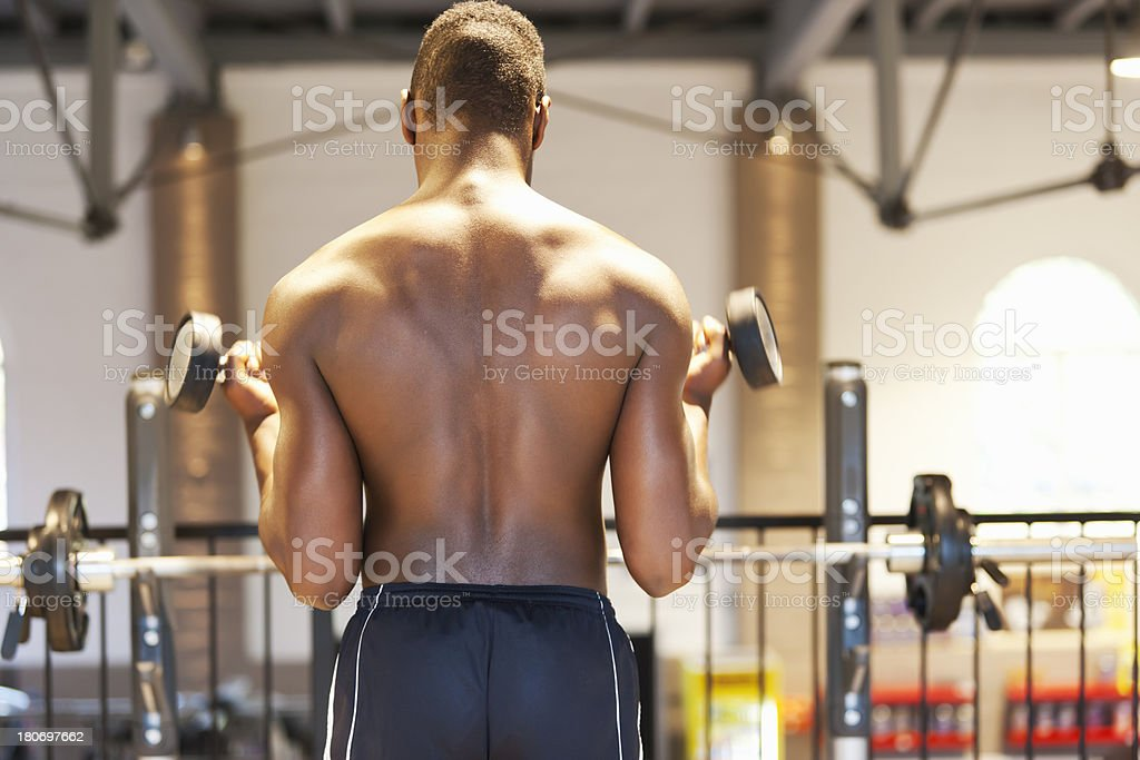 Young athlete training biceps stock photo