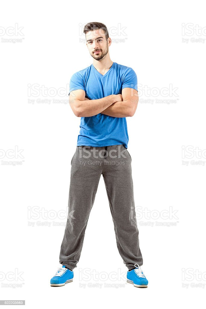 Young athlete with folded arms smiling looking at camera stock photo