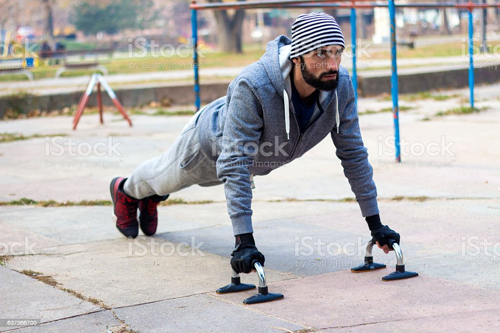 Young athlete working out   outdoor gym and lead  healthy life stock photo