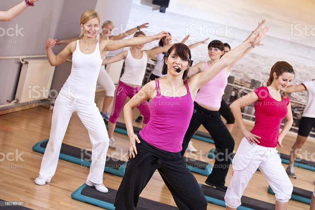 Young athletes exercasing in gym with trainer stock photo
