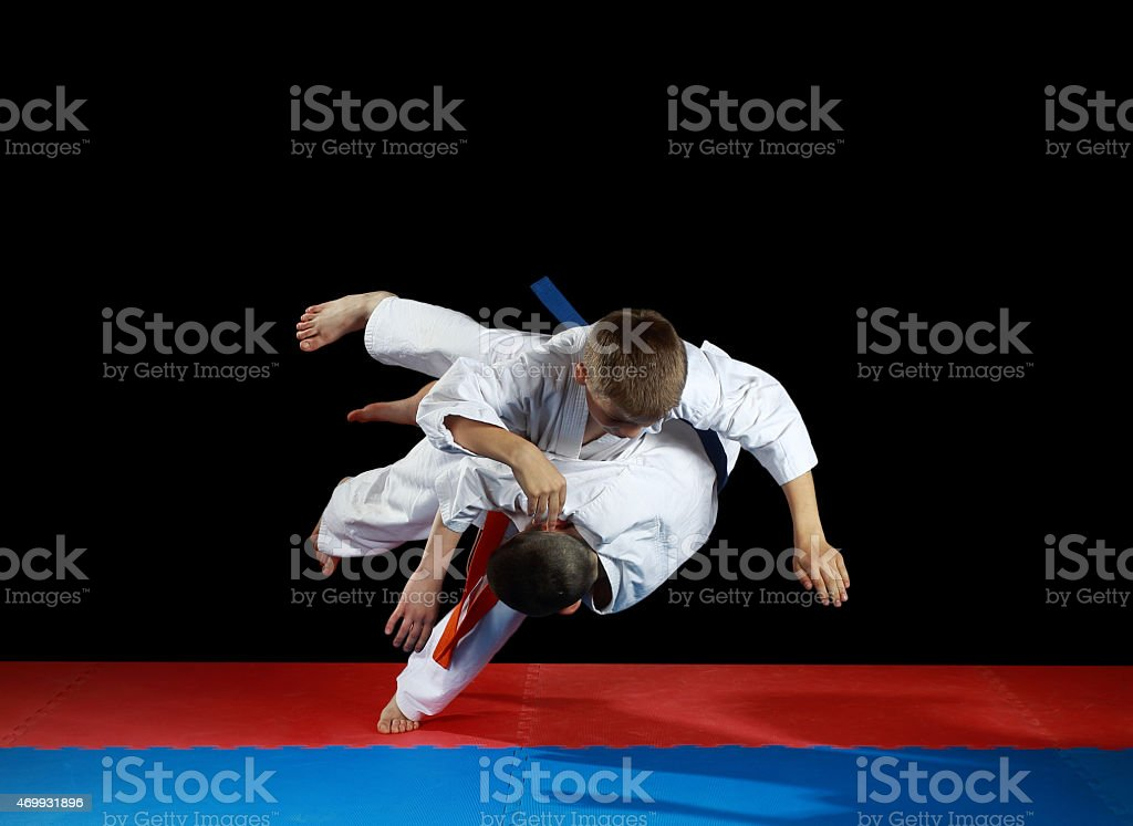 Young athletes in the sharp drop perform judo throw stock photo