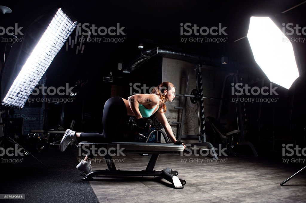 Young athletic girl in the gym stock photo