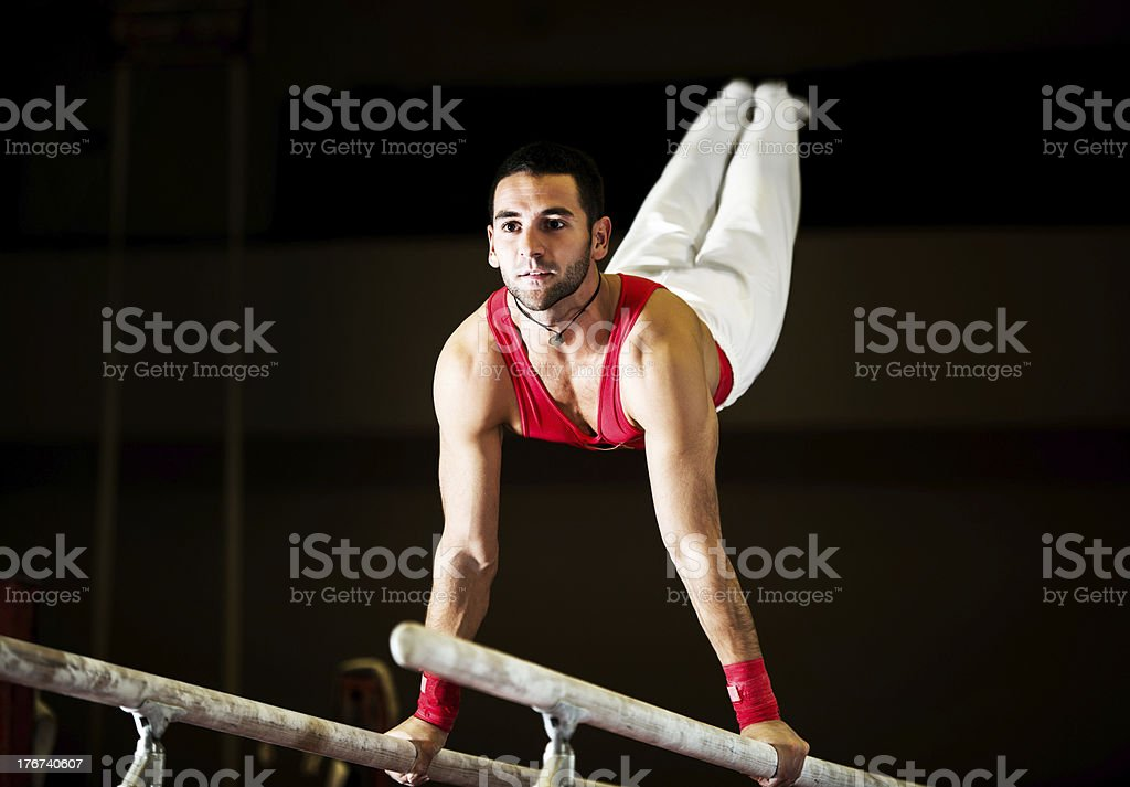 Young athletic man exercising on parallel bars. royalty-free stock photo