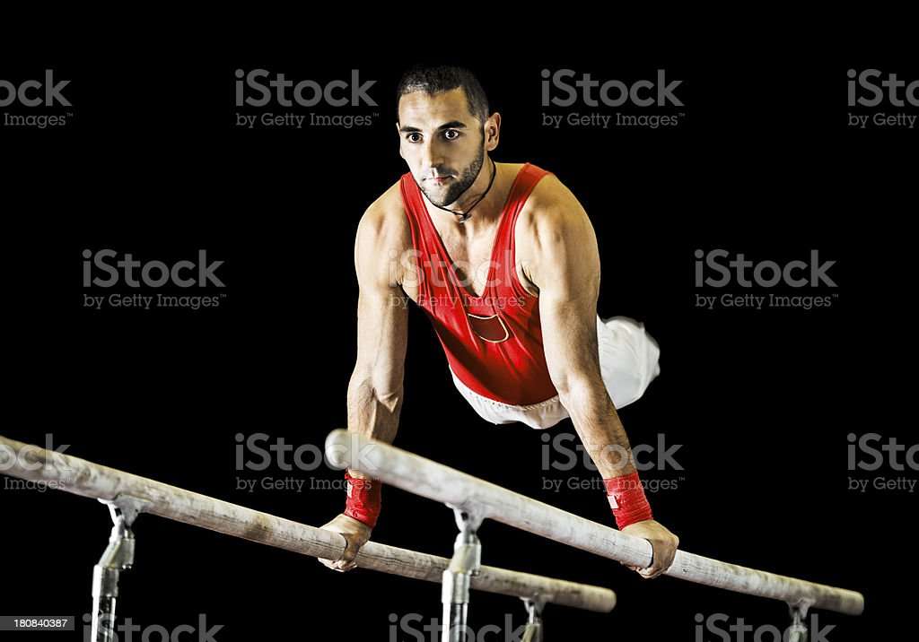 Young athletic man exercising on parallel bars. stock photo