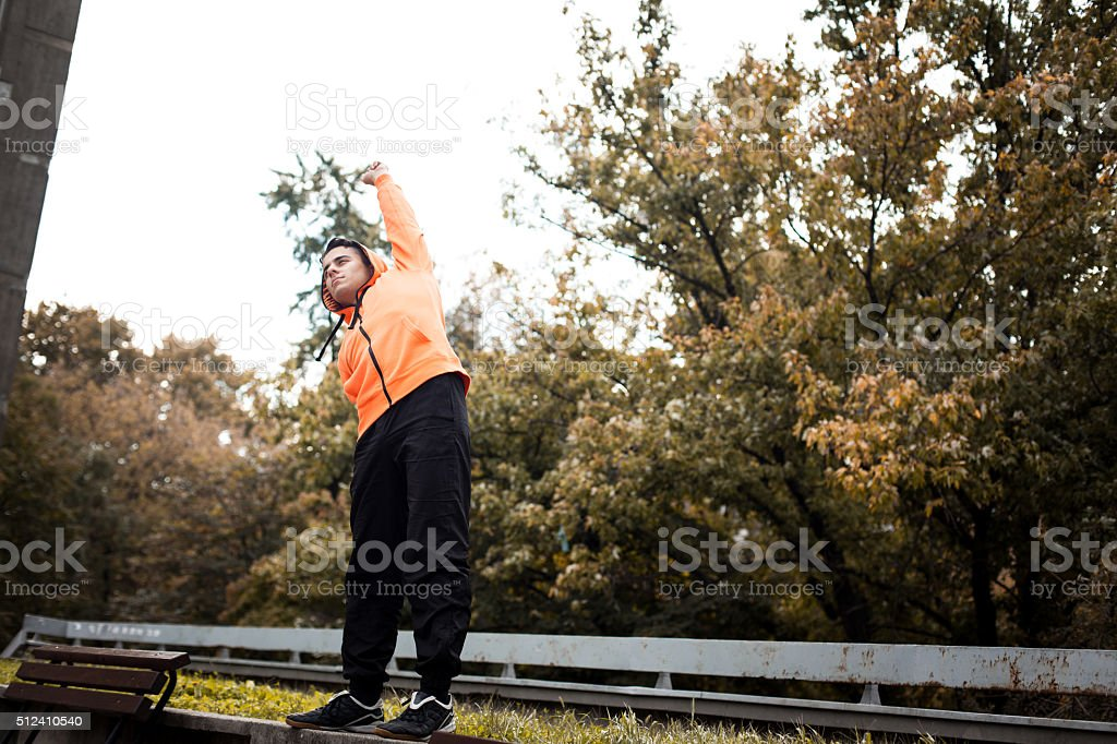 Young athletic man stretching stock photo