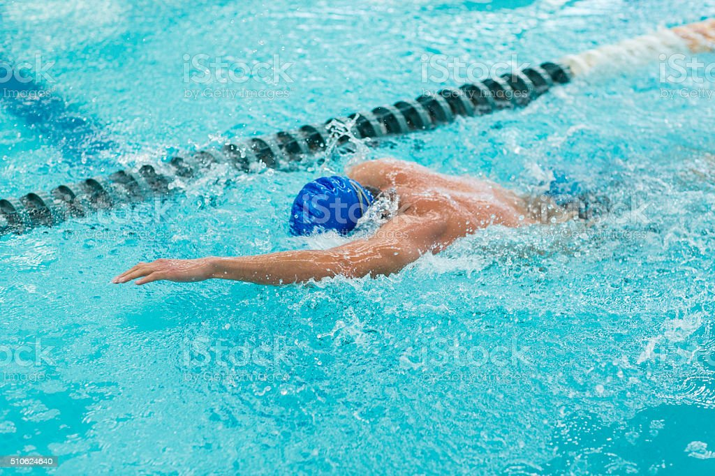 Young athletic man with butterfly swimming technique. stock photo