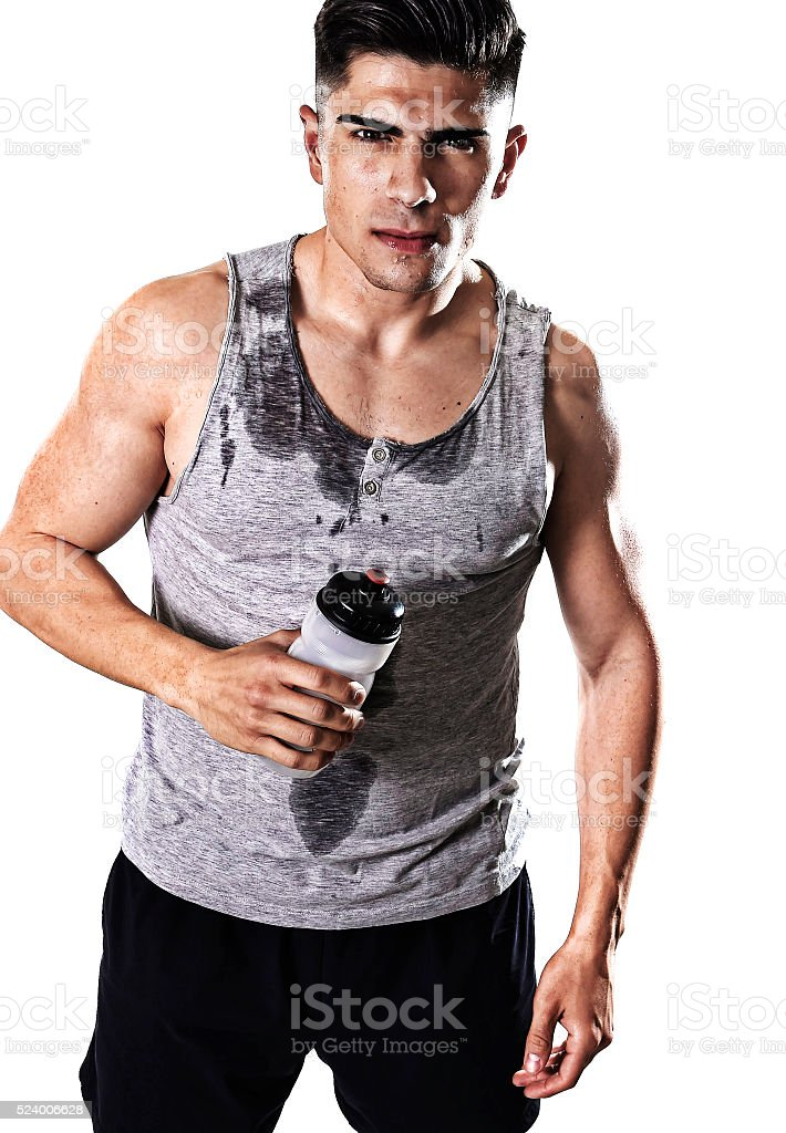 young athletic sport man thirsty holding bottle of water stock photo