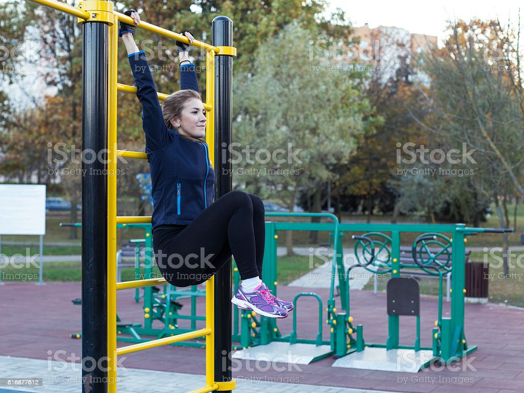 Young athletic woman doing leg rise stock photo