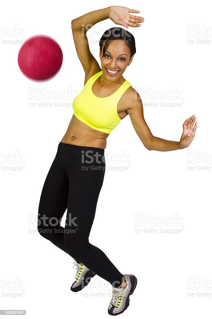 A young athletic woman playing dodgeball stock photo