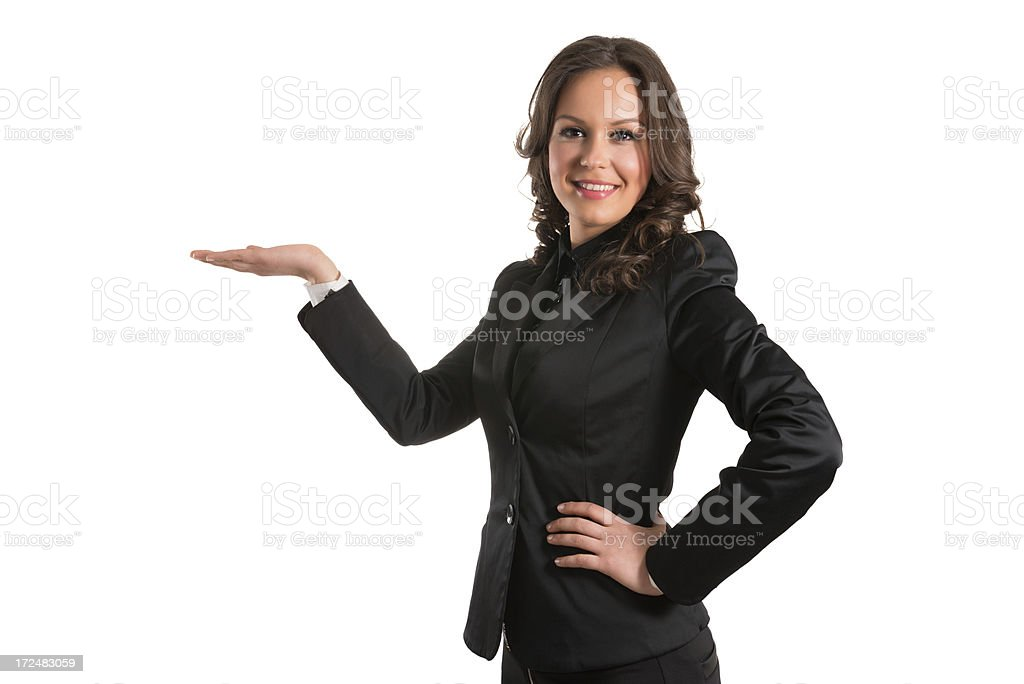 Young Attractive and Confident Businesswoman Showing You Copyspace Over White royalty-free stock photo
