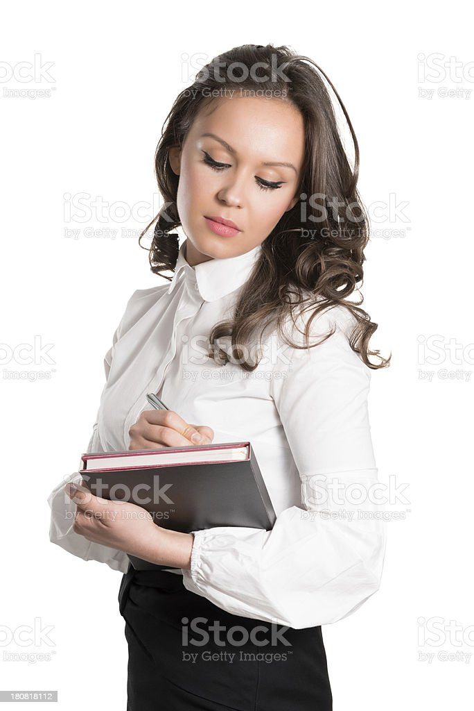 Young Attractive and Confident Businesswoman Writing on Notebook royalty-free stock photo