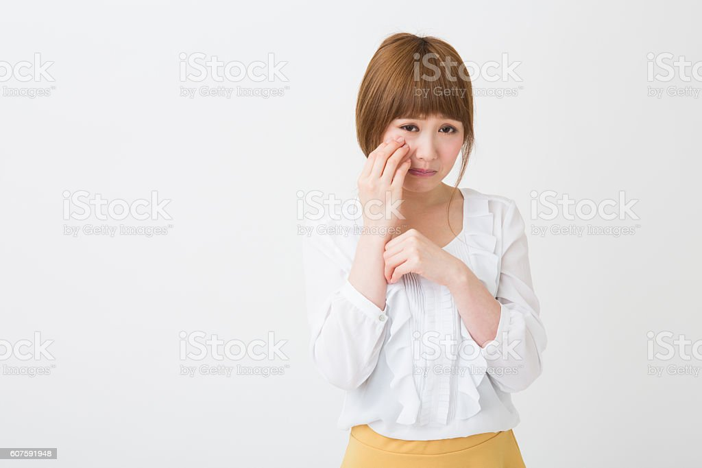 young attractive asian woman who cries stock photo