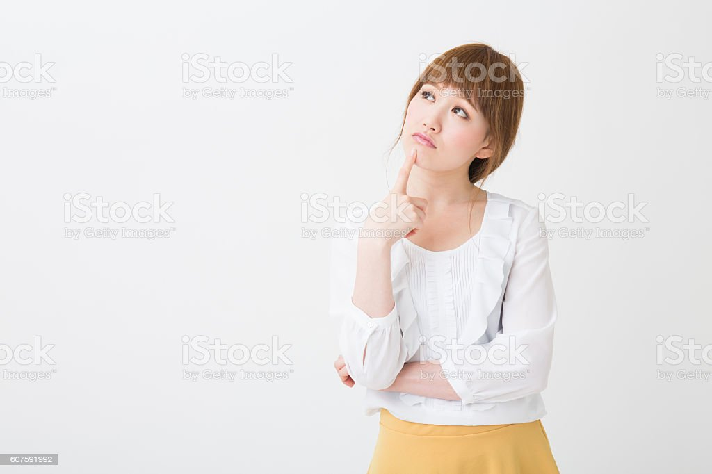 young attractive asian woman who is troubled stock photo