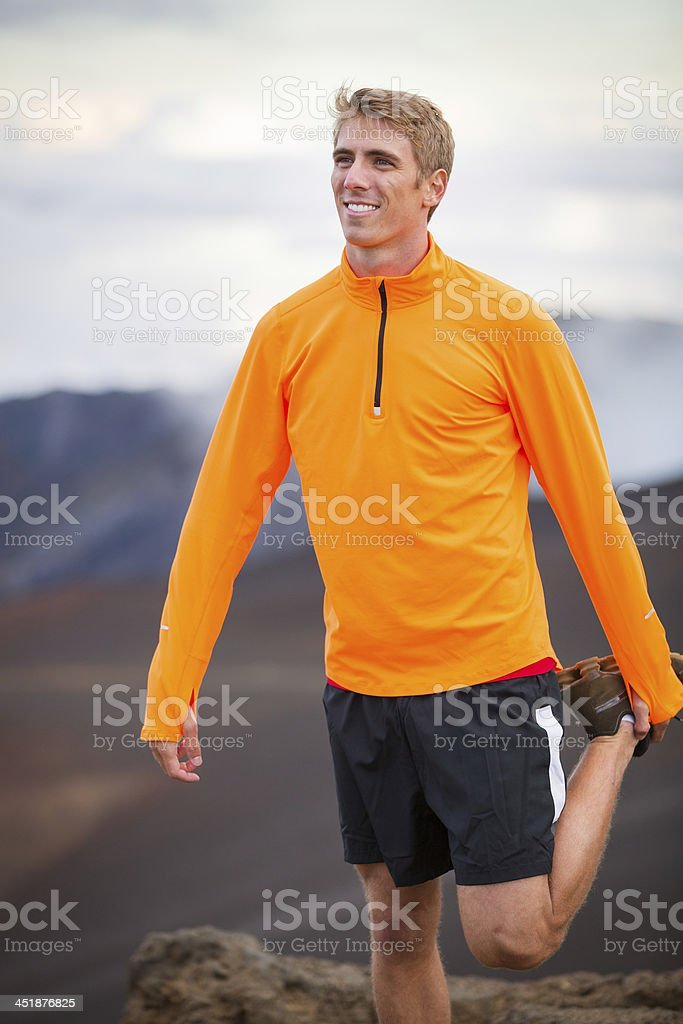 Young attractive athletic man, wearing sporty cloths on trail, s stock photo