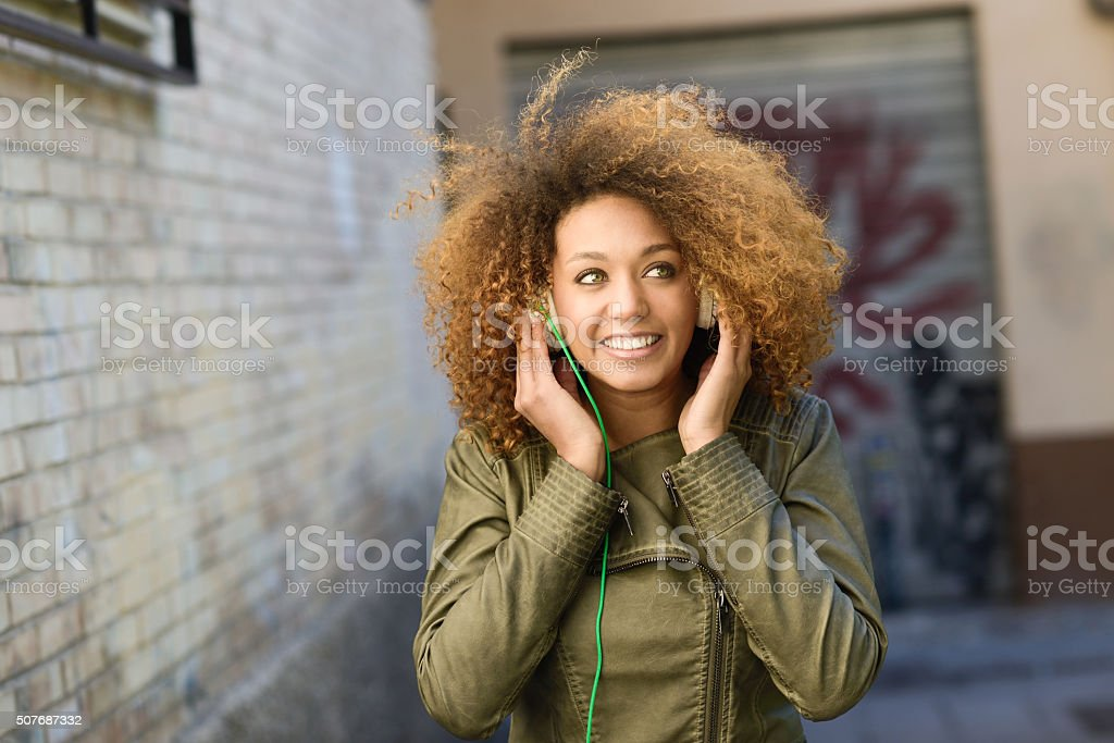 Young attractive black girl in urban background stock photo