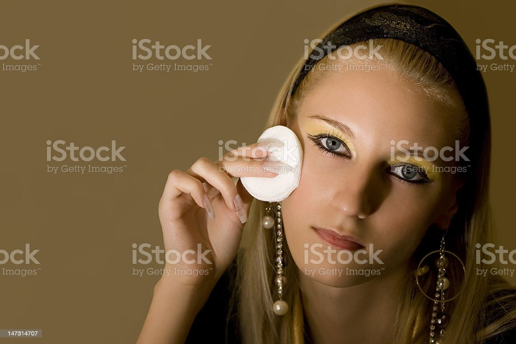 young attractive blond girl applying face pack stock photo
