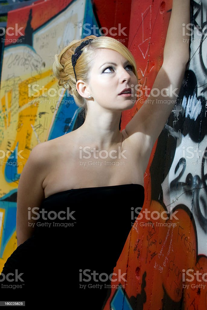 Young attractive blond woman with wedding hairdress and black dress stock photo