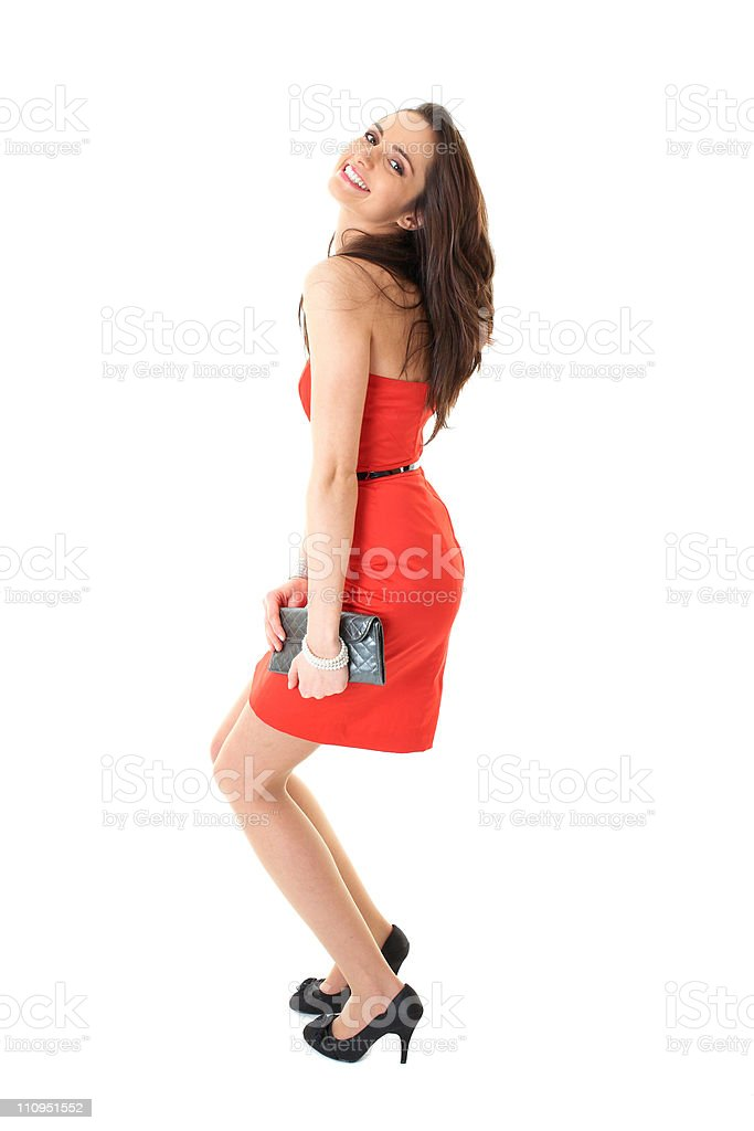 young attractive brunette female in red dress, isolated on white stock photo