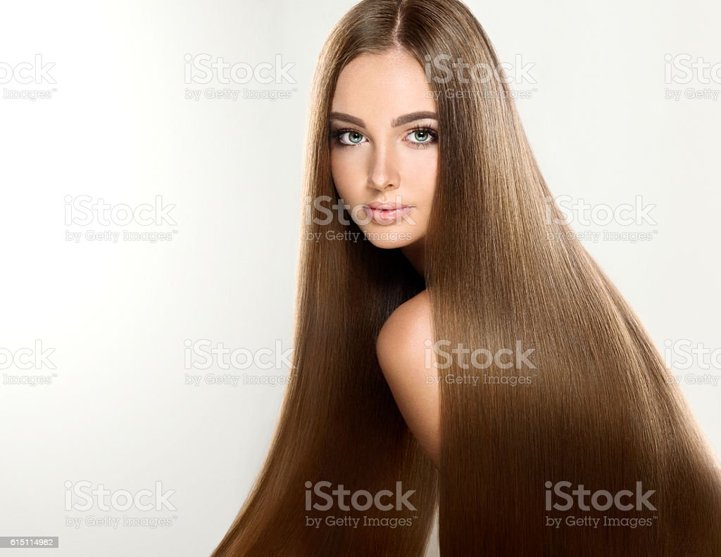 Young attractive brunette model with shiny, long, straight, brown hair. stock photo