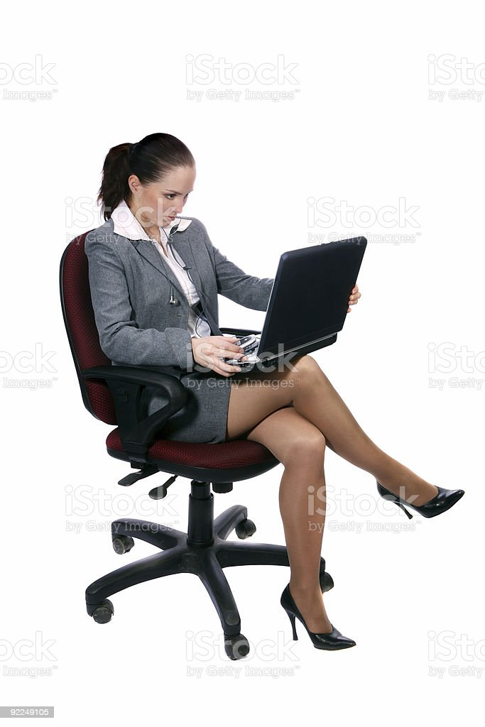 Young attractive business woman sitting on the armchair with  leptop. royalty-free stock photo