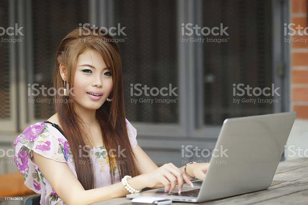 Young attractive business woman working on her laptop at outdoor royalty-free stock photo