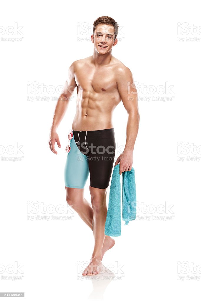 Young attractive caucasian man swimmer with goggles and towel stock photo